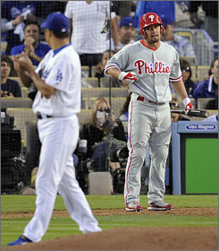Philadelphia Phillies center fielder Shane Victorino yells at Los Angeles Dodgers starter Hiroki Kuroda after Kuroda's pitch sailed near his helmet in the third inning. Victorino grounded out and exchanged more words with Kuroda near first base, sparking a confrontation between the teams.