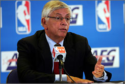 NBA Commissioner David Stern, shown at a news conference Sunday in London, said the economy was affecting season-ticket renewals.