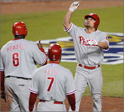Phillies center fielder Shane Victorino celebrates his two-run homer that tied the score in the eighth inning, shortly before Matt Stairs' two-run shot made it 7-5 Philadelphia. Victorino now has 11 RBI in the playoffs.