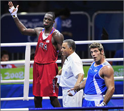 American boxer Deontay Wilder reacts to losing his semifinal bout to Italian Clemente Russo in Beijing. Wilder, a heavyweight, was the only American boxer to earn a medal  bronze.