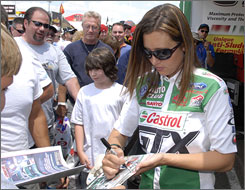 Ashley Force, taking a break to sign autographs for fans, slipped to sixth in Funny Car standings with two races left.