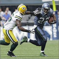 Seattle Seahawks running back Julius Jones, right, gets past Green Bay Packers safety Nick Collins on Sunday. Jones will have a much tougher time breaking free against the Buccaneers.