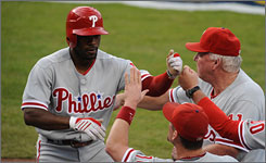 Philadelphia's Jimmy Rollins celebrates his leadoff home run in Game 5 of the NLCS in Los Angeles.