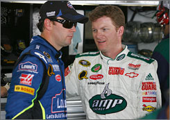 Dale Earnhardt Jr., right, says he'll do whatever he can to help Hendrick Motorsports teammate Jimmie Johnson in his push to win a third consecutive Sprint Cup title.