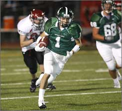 Skyline's Gino Simone heads for a touchdown against Eastlake High School on Oct. 10.