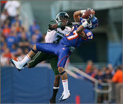 Boise State wide receiver Austin Pettis makes a first-half reception over Hawaii defensive back Jameel Dowling during a Western Athletic Conference matchup in Boise. Pettis later hauled in a 16-yard touchdown pass from quarterback Kellen Moore in the third quarter, and the Broncos rolled to a 27-7 win.