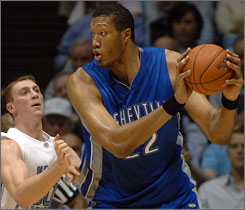 UNC-Asheville's Kenny George, shown here being defended by UNC's Tyler Hansbrough, underwent a partial amputation of his right foot after it was infected over the summer. George, 7-foot-9 and 375 pounds, averaged 12.4 points and seven rebounds a game for the Bulldogs last season, despite averaging less than 20 minutes a game.