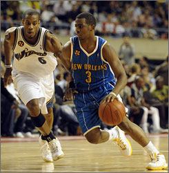 New Orleans Hornets point guard Chris Paul, right, drives around his defender, Antonio Daniels of the Washington Wizards, during the final game of the NBA Europe Live 2008 Tour in Barcelona. Paul had 10 points and eights assists as the Hornets beat the Wizards 102-80.