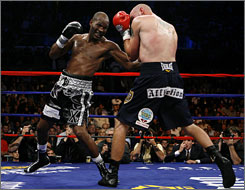 Bernard Hopkins, left, takes a shot at Kelly Pavlik during the second round of his unanimous decision victory in Atlantic City.