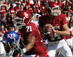 Sam Bradford had his way with the Kansas defense to lead Oklahoma to its sixth victory of the season.