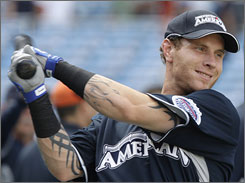The Rangers' Josh Hamilton, at the Home Run Derby in July, chronicles his path from schoolboy star to crackhead in his new book Beyond Belief.