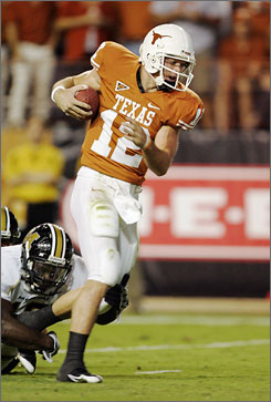 Texas quarterback Colt McCoy finished 29-of-32 passing for 337 yards, two touchdowns and two more rushing scores in the Longhorns knockdown of visiting Missouri.