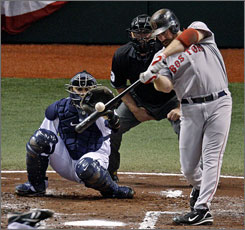 Red Sox slugger Kevin Youkilis slams a solo home run off of Rays starter James Shields in the second inning.