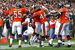 Bears defenders celebrate with Kevin Payne (44) after he grabbed one of four interceptions of Minnesota QB Gus Frerotte on Sunday.