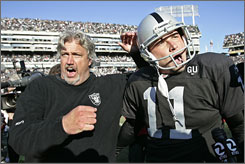 Raiders defensive coordinator Rob Ryan, left, and kicker Sebastian Janikowski celebrate the team's overtime win vs. the Jets.
