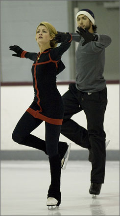 Tanith Belbin, left, and Ben Agosto work on their routine at IceWorks, their new training facility near Philadelphia.