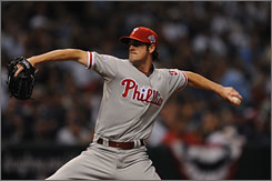 Phillies starting pitcher Cole Hamels pitches to the Rays in Game 1 of the World Series. Hamels gave up two runs and five hits in seven innings, striking out five. He left the game with a 3-2 lead and the earned the win. Hamels is now 4-0 in the 2008 playoffs.
