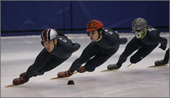 Apolo Anton Ohno, left, practices at the Utah Olympic Oval this month. He will compete at the second World Cup of the season this weekend in Vancouver, site of the 2010 Olympics.