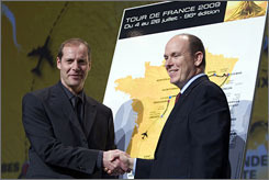 Tour de France director Christian Prudhomme, left, shakes hands with Prince Albert of Monaco on Wednesday at the unveiling of the 2009 Tour de France route. The race will begin in Monaco on July 4 and finish on July 26.