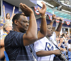 Manny and Yvonne Upton root for their son, Rays center fielder B.J. Upton, in Game 1 of the World Series at Tropicana Field.