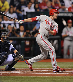 Phillies second baseman Chase Utley hits a two-run home run in the top