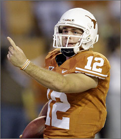 Colt McCoy and the top-ranked Texas Longhorns will battle No. 8 Oklahoma State Saturday in Austin.
