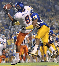 Boise State receiver Jeremy Childs catches a touchdown pass against the coverage of San Jose State's Christopher Owens during the second quarter. Quarterback Kellen Moore threw for 242 yards and two scores as the 13th-ranked Broncos beat their WAC rivals 33-16.