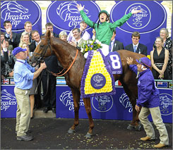 Jockey Frankie Dettori celebrates aboard Raven's Pass after they upset Curlin in the Breeders' Cup Classic.