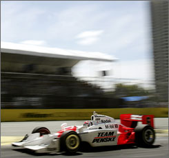 Team Penske driver Ryan Briscoe races on his way to winning the Indy 300 on the Surfers Paradise street circuit on the Gold Coast in Australia.