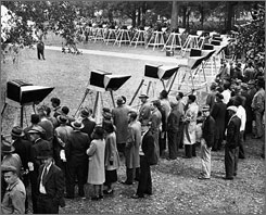 Fans gather around 100 television sets installed in Boston Common to watch the 1948 World Series between the then-Boston Braves and Cleveland Indians.