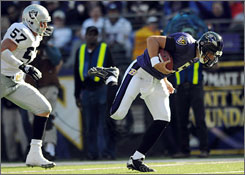 Ravens QB Joe Flacco caught a 43-yard pass in Sunday's defeat of the Raiders.
