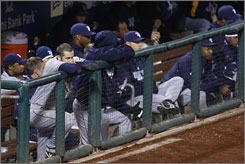 Evan Longoria, left, and his Tampa Bay teammates look on from the dugout during the ninth inning of Game 4 of the World Series at Citizens Bank Park in Philadelphia. The Phillies beat the Rays 10-2 to take a 3-1 Series lead.