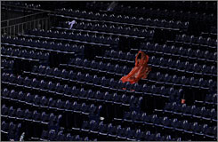 A lone fan braves the conditions at Citizens Bank Park during the rain delay in the sixth inning before Monday night's game was suspended.