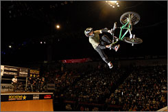 Jamie Bestwick, performing a downside tailwhip air at the 2007 Action Sports World Championships in Dallas, says his commentating duties have helped him improve his own riding.