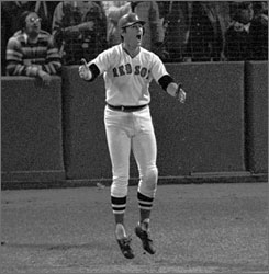 Carlton Fisk wills his famous 1975 World Series home run fair. The shot won Game 6 for the Boston Red Sox, who lost the next night to the Cincinnati Reds.