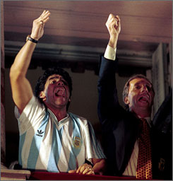Argentine soccer star Diego Maradona, left, and former coach Carlos Bilardo, wave to a crowd of fans from the balcony of the country's government palace on July 9, 1990, after Argentina finished second in the World Cup. Maradona and Bilardo have been asked to lead Argentina's national team by Julio Grondona, head of the Argentine Football Association.