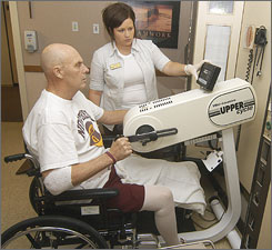 Northern State University basketball coach Don Meyer goes through occupational therapy as part of his recovery from a car accident in September, which also led to the discovery of cancer in his liver and small intestine.