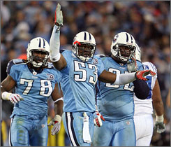 Keith Bulluck, center, and the Titans are the NFL's only unbeaten team at 7-0.