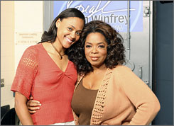 Marion Jones, left, poses with Oprah Winfrey prior to the taping of her show on Oct. 24.