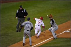 The Phillies' Jimmy Rollins is caught in a rundown in Game 4, but is called safe by umpire Tim Welke despite the protests of Rays' pitcher Andy Sonnanstine and third baseman Evan Longoria.