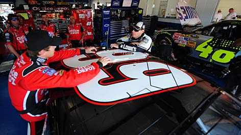 Jimmie Johnson, right, and Carl Edwards talk shop in the garage area during the Chase's Talladega round. Johnson carries an 183-point edge over Edwards into the season's final three Sprint Cup races.