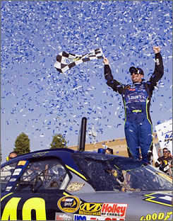 Jimmie Johnson celebrates winning the Camping World RV 400 at Kansas Speedway. Johnson's recent performance has sparked debate over whether the Chase for the Sprint Cup should be tweaked because of his dominance.