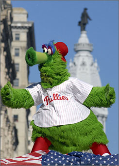 The Philly Phanatic dances in front of City Hall during the Phillies' victory parade on Friday.