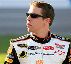 Brad Keselowski gets his bearings on pit road at Texas Motor Speedway.