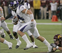 Brendan Smith's interception and return in the final minute gave Northwestern a stunning defeat of Minnesota.