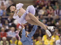 Yuko Kawaguchi and Alexander Smirnov perform during the pairs free skating program at the 2008 Skate Canada International figure skating competition in Ottawa. Kawaguchi and Smirnov edged the team from Canada to winthe pairs competition.