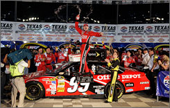 Carl Edwards celebrates his victory in the Dickies 500 at Texas Motor Speedway on Sunday evening.