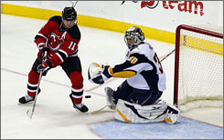 Sabres goalie Ryan Miller, stopping John Madden's shot for the Devils in the third period, registered 24 saves for his second consecutive shutout.
