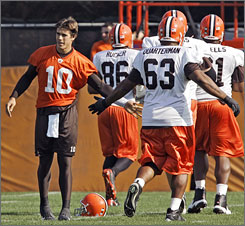 """I'll have to dust off the ol' cleats and shoulder pads and everything,"" Brady Quinn, left, said Tuesday of becoming the Browns' starting QB. ""It's going to be fun to get back out there."""