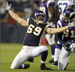 Minnesota Vikings' defensive end Jared Allen, center, celebrates with teammate Ray Edward after a sack of Indianapolis Colts' quarterback Peyton Manning Sept. 14. Allen's sprained right shoulder has left him questionable for Sunday's game against the Green Bay Packers.